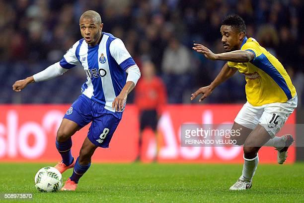 Porto's Argelian forward Yacine Brahimi vies with Arouca's Cape Verdean defender Admilson Barros Gege during the Portuguese League football match FC...