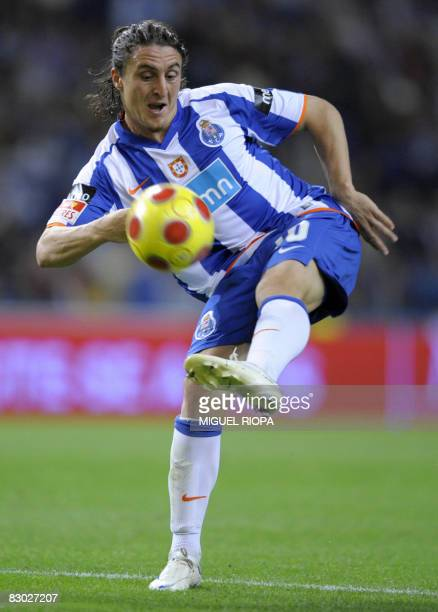 Porto's Argentinian Cristian Rodriguez kicks the ball during a Portuguese Super league football match against Pacos Ferreira at the Dragao Stadium in...