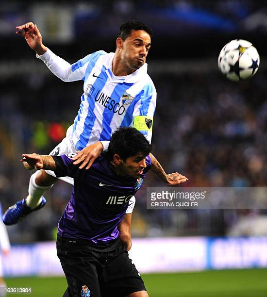 Porto's Argentinian midfielder Lucho Gonzales vies with Malaga's Brazilian defender Weligton during the UEFA Champions League round of 16 second leg...