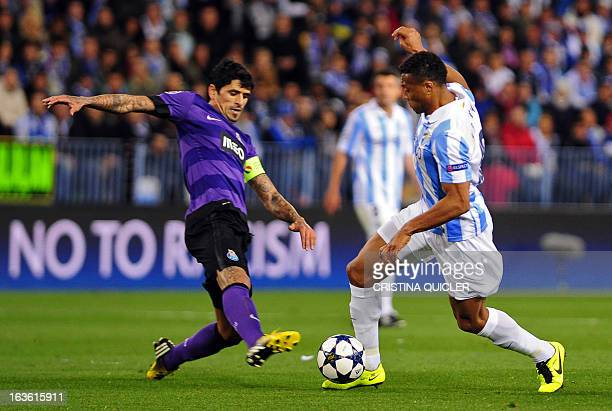 Porto's Argentinian midfielder Lucho Gonzales vies with Malaga's Brazilian midfielder Julio Baptista during the UEFA Champions League round of 16...