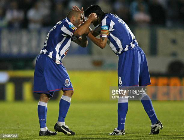 FC Porto's Argentinians Lisandro Lopez and Lucho Gonzalez celebrate after scoring a 2nd goal against Pacos Ferreira during their Portuguese Super...
