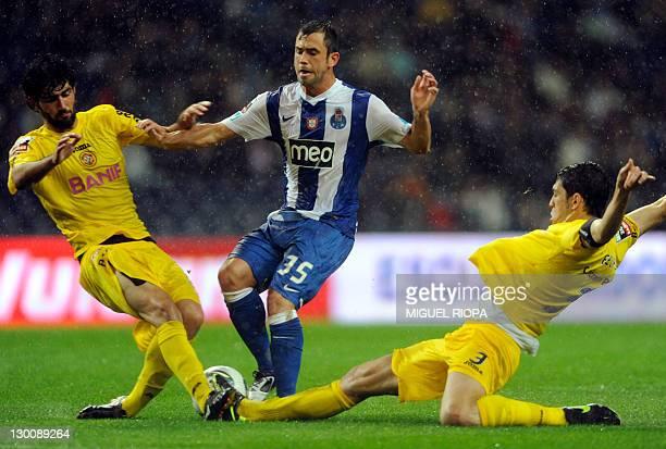 FC Porto's belgian midfielder Steven Defour vies with CD Nacional's Luis Neto and defender Felipe Lopes during their Portuguese Super League football...