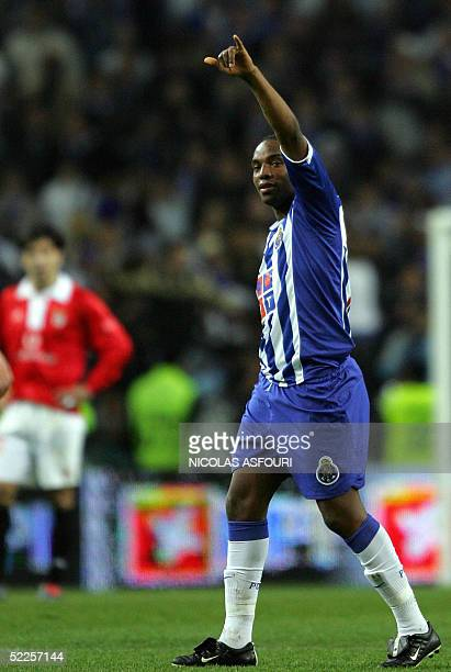 Porto's Benni McCarthy celebrates after scoring the opening goal during the clash SL Benfica against FC Porto in the Dragon stadium in Porto 28...