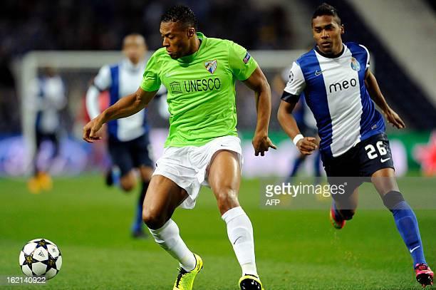 Porto's Brazilian defender Alex Sandro vies with Malaga's Brazilian midfielder Julio Baptista during the UEFA Champions League round of 16 first leg...