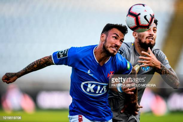 Porto's Brazilian defender Alex Teles challenges Belenenses' Portuguese defender Diogo Viana during the Portuguese League football match between Os...
