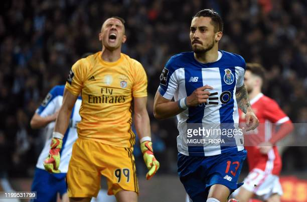 FC Porto's Brazilian defender Alex Telles celebrates after scoring a goal during the Portuguese league football match between FC Porto and SL Benfica...
