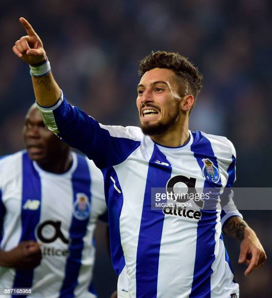 Porto's Brazilian defender Alex Telles celebrates after scoring a goal during their UEFA Champions League group G football match FC Porto vs Monaco...