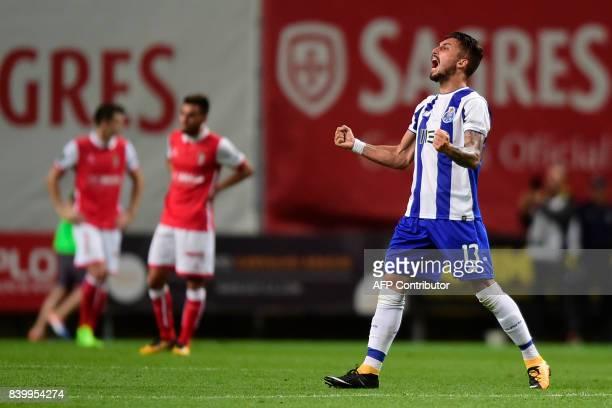 Porto's Brazilian defender Alex Telles celebrates at the end of the Portuguese league football match Sporting Clube de Braga vs FC Porto at the...