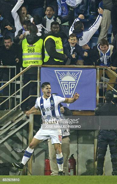 Porto's Brazilian defender Alex Telles celebrates his goal during the Portuguese league football match GD Estoril Praia vs FC Porto at the Antonio...