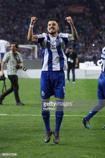 Porto's Brazilian defender Alex Telles celebrates the title of national champion during the Premier League 2017/18 match between FC Porto and CD...