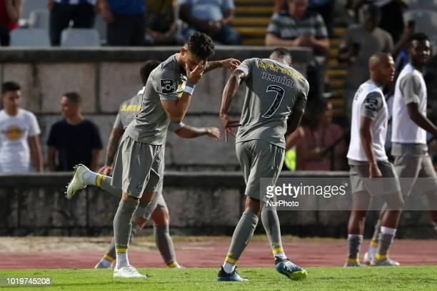 Porto's Brazilian defender Alex Telles celebrates with forward Hernani after scoring during the Portuguese League football match Belenenses vs FC...