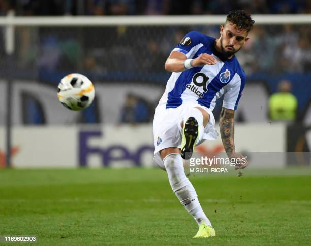 FC Porto's Brazilian defender Alex Telles kicks the ball during the UEFA Europa League group G match FC Porto against Young Boys at the Dragao...