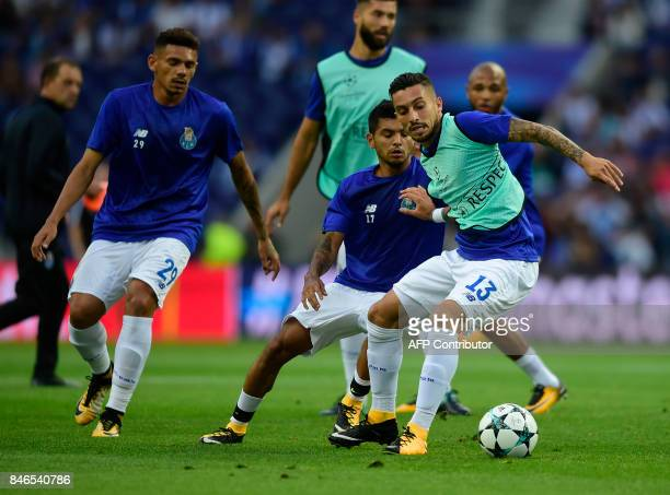 Porto's Brazilian defender Alex Telles Porto's Mexican forward Jesus Corona and Porto's Brazilian forward Soares warm up before the UEFA Champions...