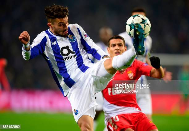 Porto's Brazilian defender Alex Telles vies with Monaco's Portuguese midfielder Rony Lopes during their UEFA Champions League group G football match...
