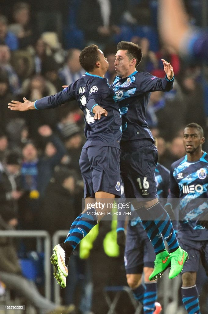 Porto's Brazilian defender Danilo (L) and Porto's Mexican midfielder Hector Herrera celebrate after Danilo scored a penalty kick to equalize during the UEFA Champions League round of 16 first leg football match between Basel (FCB) and Porto (FCP) on February 18, 2015 at the St. Jakob-Park stadium in Basel.