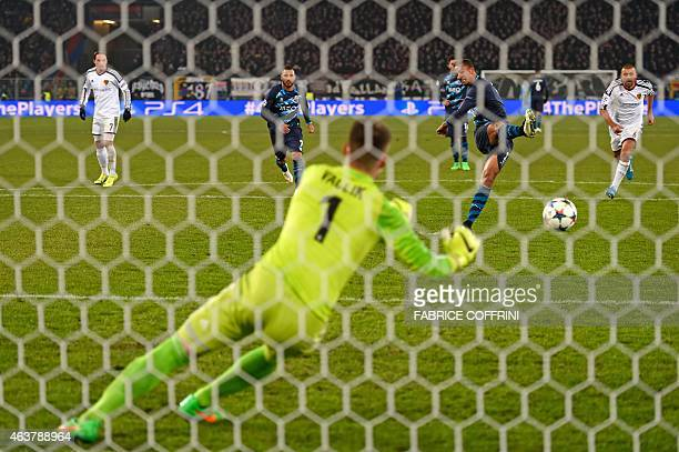 Porto's Brazilian defender Danilo scores a penalty kick past Basel's Czech goalkeeper Tomas Vaclik to equalize during the UEFA Champions League round...