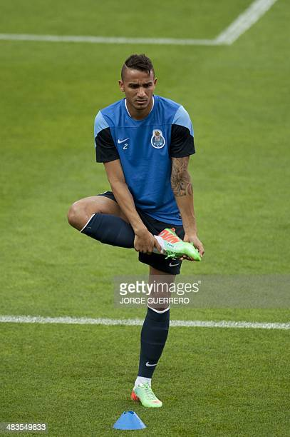 Porto's Brazilian defender Danilo stetches during a training session at the Ramon Sanchez Pizjuan stadium in Sevilla on April 9 on the eve of the...