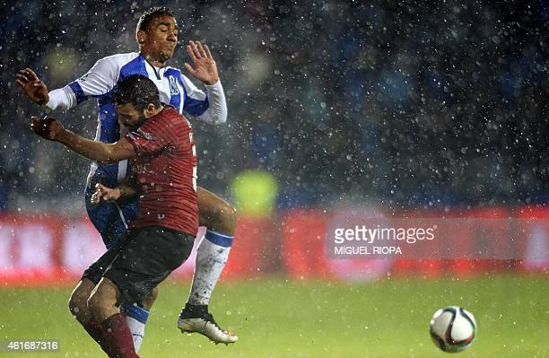 Porto's Brazilian defender Danilo vies with Penafiel's midfielder Andre Fontes during the Portuguese liga football match FC Penafiel vs FC Porto at...