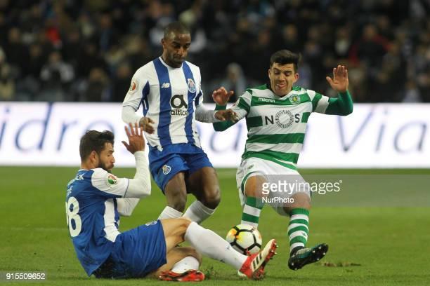 Porto's Brazilian defender Felipe and Porto's Portuguese defender Ricardo Pereira with Sporting's Argentinian midfielder Rodrigo Battaglia during the...