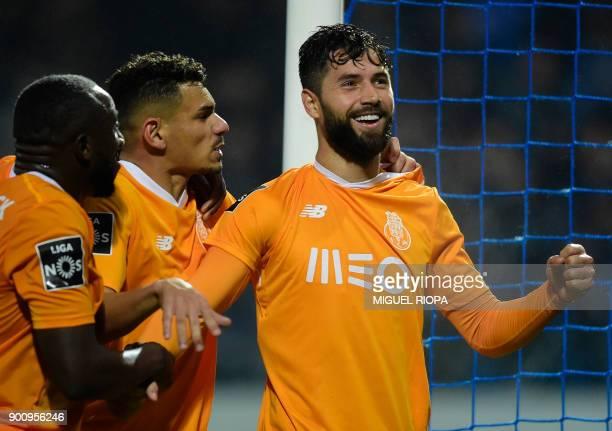 Porto's Brazilian defender Felipe celebrates a goal with teammates during the Portuguese league football match CD Feirense vs FC Porto at the...