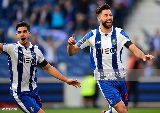 Porto's Brazilian defender Felipe celebrates with teammate midfielder Andre Silva after scoring during the Portuguese league football match FC Porto...