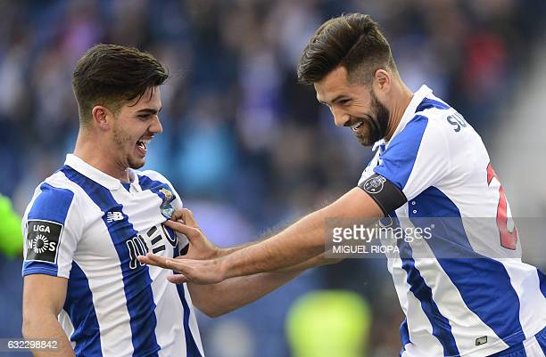 Porto's Brazilian defender Felipe is congratulated by teammate midfielder Andre Silva after scoring the opening goal during the Portuguese league...