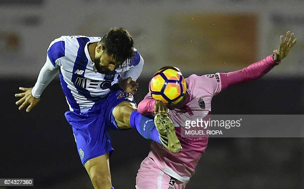 TOPSHOT Porto's Brazilian defender Felipe jumps for the ball with Chaves' Brazilian forward William Oliveira during the Portuguese Cup football match...