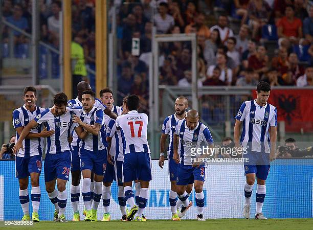 FC Porto's Brazilian defender Felipe Monteiro celebrates with his teammates after scoring during the UEFA Champions League second leg play off...
