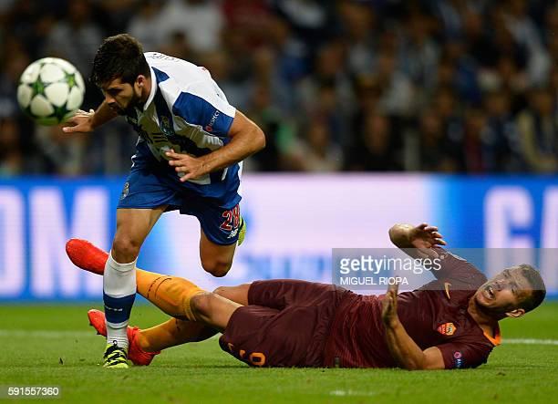 Porto's Brazilian defender Felipe vies with AS Roma's Bosnian forward Edin Dzeko during the UEFA Champions League first leg play off football match...