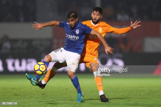 Porto's Brazilian defender Felipe vies with Feirense's Portuguese forward Hugo Seco during the Premier League 2016/17 match between CD Feirense and...
