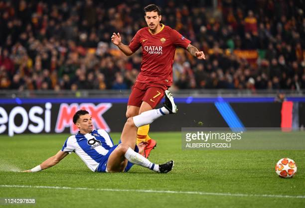 Porto's Brazilian defender Pepe tackles AS Roma Italian midfielder Lorenzo Pellegrini during the UEFA Champions League round of 16 first leg football...