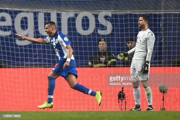 Porto's Brazilian forward Fernando Andrade celebrates past Sporting's Brazilian goalkeeper Renan Ribeiro after scoring a goal during the Portuguese...