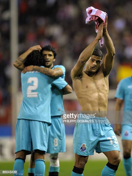 Porto's Brazilian forward Gevanildo Hulk waves to supporters after the Champions League football match against Atletico Madrid at the Vicente...