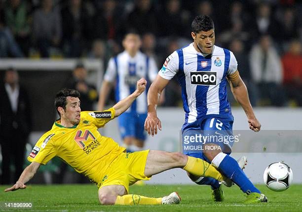 FC Porto's Brazilian forward Givanildo de Souza 'Hulk' vies with Pacos Ferreira's midfielder Luis Pinto 'Luisinho' during their Portuguese super...
