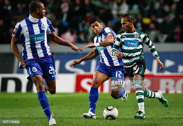 FC Porto's Brazilian forward Givanildo Hulk de Souza fights for the ball with Sporting's striker Liedson Muniz during the Portuguese League football...
