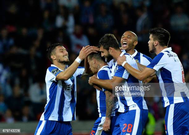Porto's Brazilian forward Otavio celebrates with teammates after scoring the opening goal during the Portuguese league football match CS Maritimo vs...