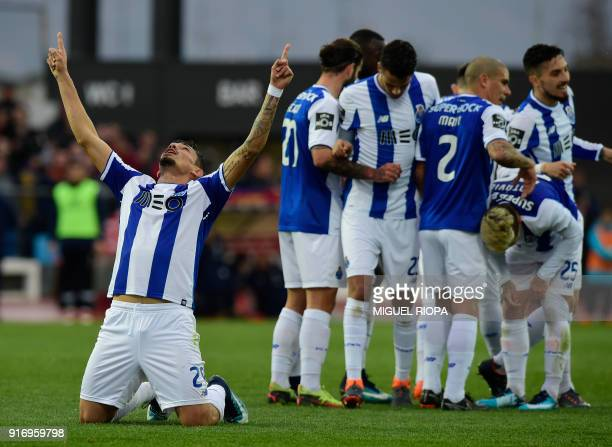 Porto's Brazilian forward Soares celebrates a goal beside teammates during the Portuguese league football match between GD Chaves and FC Porto at the...