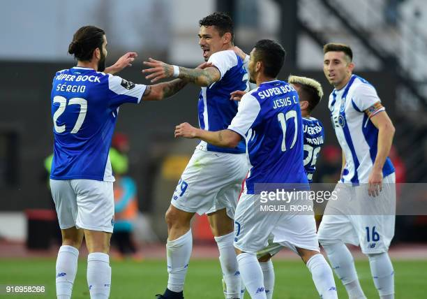 Porto's Brazilian forward Soares celebrates a goal with teammates during the Portuguese league football match between GD Chaves and FC Porto at the...