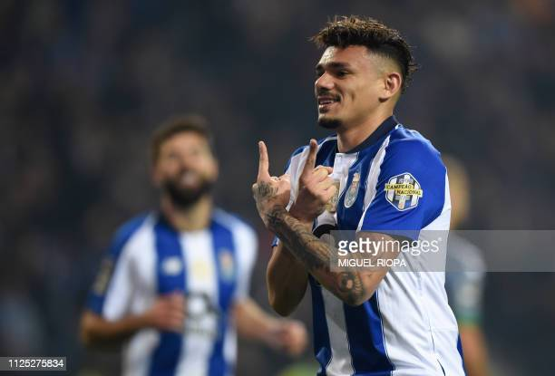 Porto's Brazilian forward Soares celebrates after scoring a goal during the Portuguese League football match between Porto and Vitoria Setubal at the...