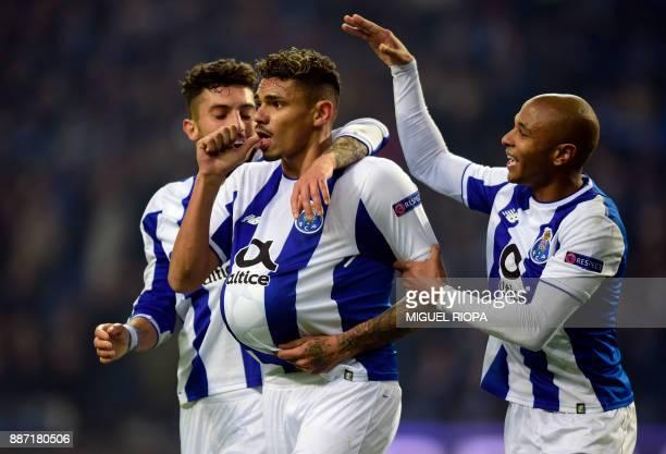 Porto's Brazilian forward Soares celebrates with teammates Porto's Brazilian defender Alex Telles and Porto's Algerian forward Yacine Brahimi after...