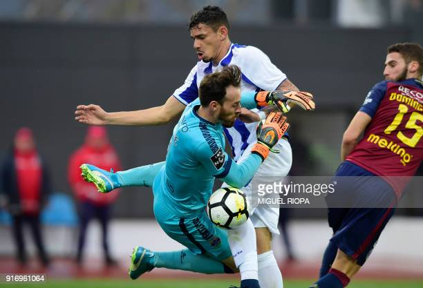 Porto's Brazilian forward Soares clashes with Chaves' Portuguese goalkeeper Antonio Filipe during the Portuguese League football match between GD...