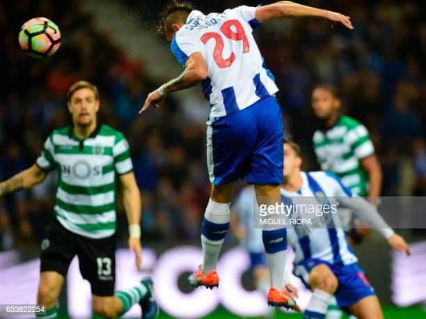 Porto's Brazilian forward Soares heads the ball to score a goal during the Portuguese league football match FC Porto vs Sporting CP at the Dragao...