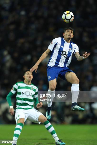 Porto's Brazilian forward Soares in action with Sporting's Argentinian midfielder Rodrigo Battaglia during the Portuguese Cup 2017/18 match between...