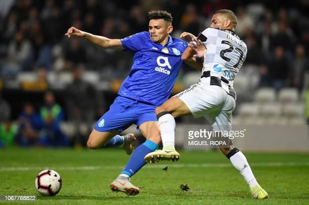 Porto's Brazilian forward Soares kicks the ball next to Boavista's Brazilian defender Neris during the Portuguese league football match between...