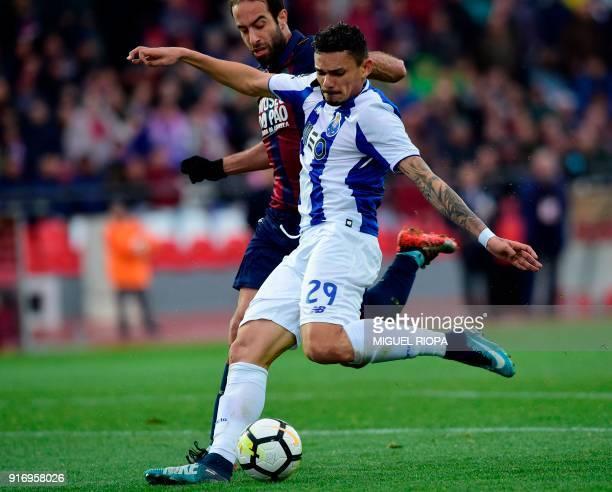 Porto's Brazilian forward Soares kicks the ball to score a goal beside Chaves' Portuguese midfielder Filipe Melo during the Portuguese league...