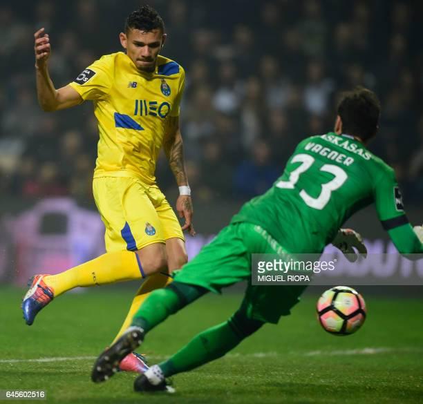 Porto's Brazilian forward Soares shoots to score a goal in front of Boavista's Brazilian goalkeeper Vagner during the Portuguese league football...