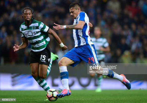 Porto's Brazilian forward Soares vies with Sporting's defender Ruben Semedo before scoring his second goal during the Portuguese league football...