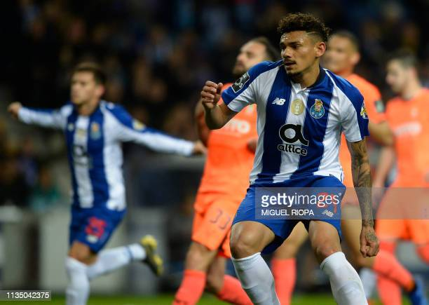 Porto's Brazilian forward Tiquinho Soares celebrates after scoring a goal during the Portuguese league football match between FC Porto and Boavista...