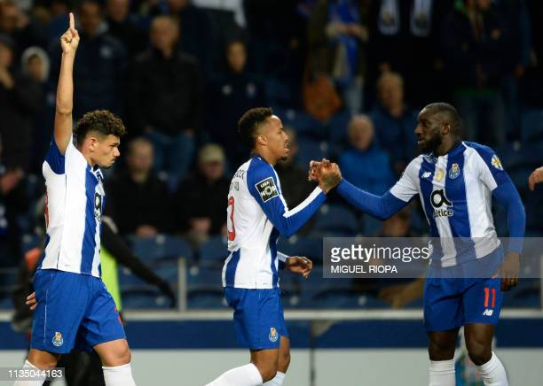 Porto's Brazilian forward Tiquinho Soares celebrates his goal beside teammates Brazilian defender Eder Militao and Malian forward Moussa Marega...