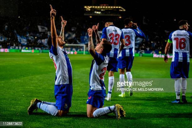 TOPSHOT Porto's Brazilian forward Tiquinho Soares celebrates his goal with teammates during the UEFA Champions League round of 16 second leg football...